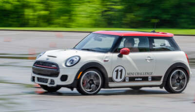 White MINI at Speed in Wet